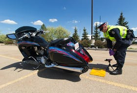 In this file photo, police constable Trevor Henderson of the Edmonton Police Service's traffic section tests the noise level of a motorcycle. — Greg Southam