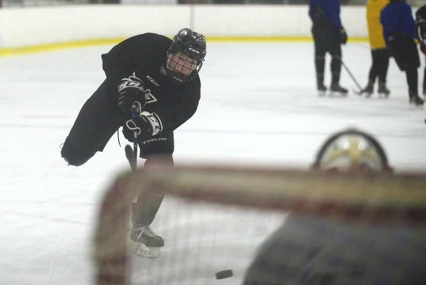 Mount Academy Saints defenceman Aiden Diamond, a Stratford native, fires a shot on goal during Tuesday's practice at MacLauchlan Arena.