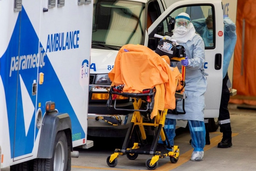 A paramedic transports a patient to Mount Sinai Hospital in Toronto, April 17, 2020.