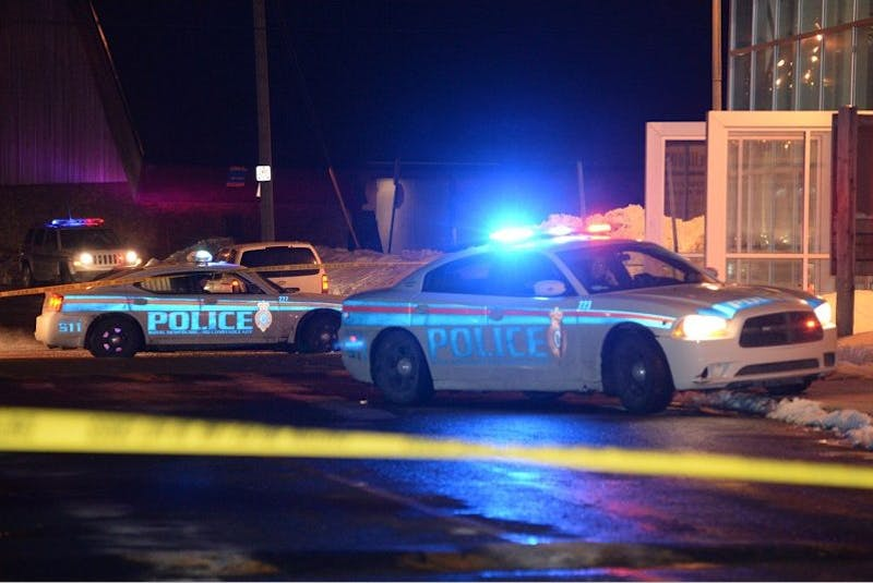 Royal Newfoundland Constabulary street patrol vehicles are shown outside the MUN Field House Feb. 19, 2014 after a plainclothes police officer drew his weapon and fired at Justin Chipman who was driving an SUV towards officers trying to arrest him. — SaltWire Network File Photo