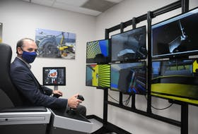 Joe Singleton, assistant head of the Marine Institute's school of ocean technology, sits at one of the new simulators students will use in the underwater exploration laboratory. — Andrew Robinson/The Telegram