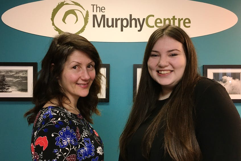 Lindsay Oates (left) co-ordinator of an upcoming career expo chats with Murphy Centre client Danika Carter. BARB SWEET/THE TELEGRAM