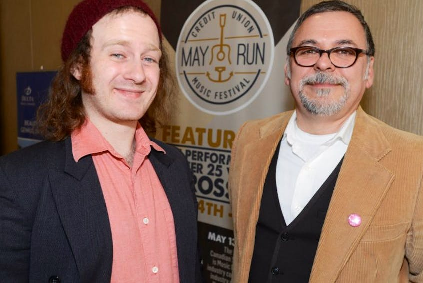 Rob Oakie, right, welcomes Music P.E.I. nominee Spencer Soloduka to the press conference announcing the inaugural Music P.E.I. May Run Music Festival.