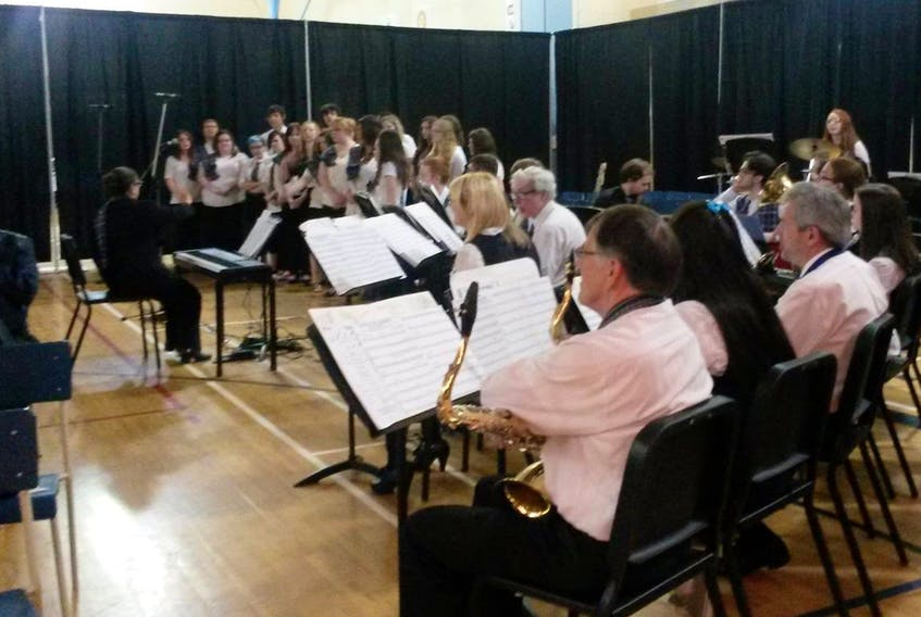 Members of the community join with members of the Sydney Academy band during a recent event in Sydney. CONTRIBUTED