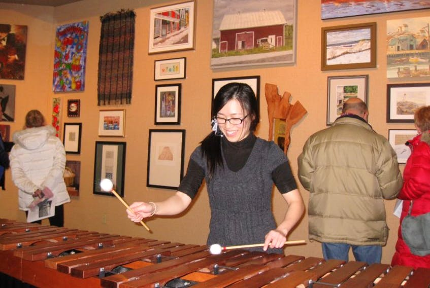 <p>Naoko Tsujita will play a marimba concerto by Emmanuel Séjourné at the upcoming Tom Regan Concert. She performed recently at the opening of the Acadia Art Gallery's community exhibition.</p>