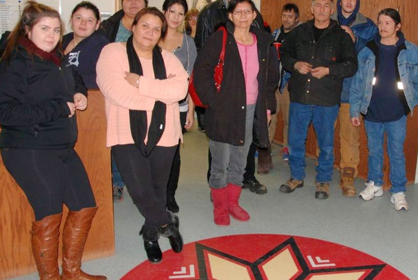 Members of the Native Council of P.E.I. stand their ground in protest Thursday night at the Council's offices in Charlottetown.
