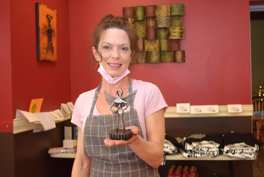 Crystal Blair (aka Angel), owner of the Glenholme Loop Petro Pass Restaurant, is seen with the angel statute she received last year for her generous gestures of support for truckers during the early days of the COVID pandemic. Now, Donnelly Farms Ltd. of N.B. is challenging other trucking companies to pay for their drivers' meals if they eat at the diner during March.