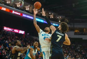 Marvell Waithe of the Halifax Hurricanes goes up for a shot as Mike Edwards of the St. John's Edge defends during an NBL Canada game earlier this season at Scotiabank Centre. RYAN TAPLIN / The Chronicle Herald