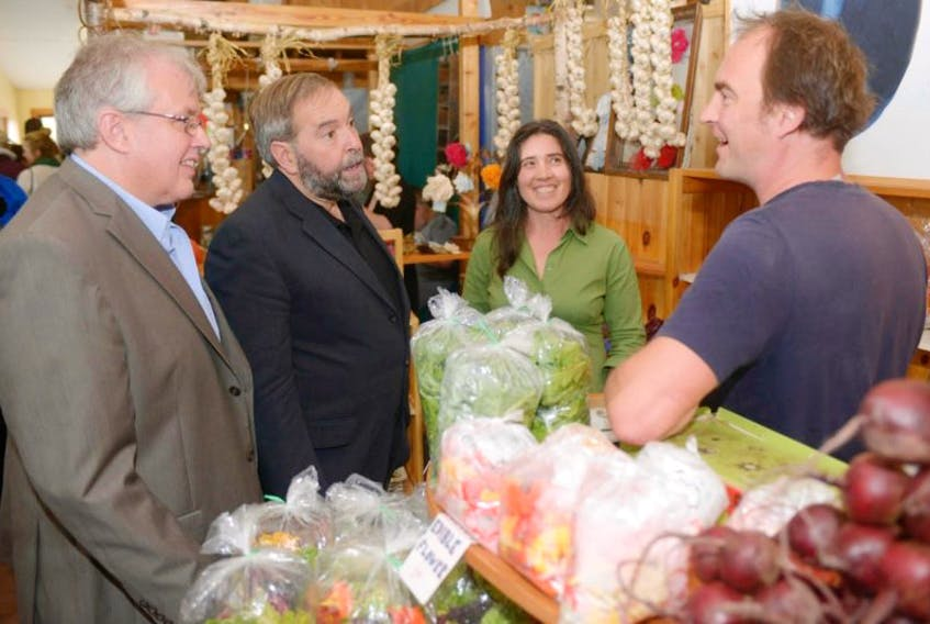 <p>Federal NDP leader Tom Mulcair and &nbsp;Charlottetown candidate Joe Byrne chat with Angel McKann and Hans Wendt at a Charlottetown Farmer's Market booth on Saturday.</p>