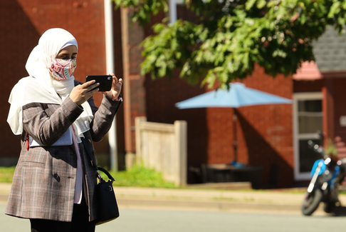 Health-care reporter Nebal Snan covers a news event for The Chronicle Herald in Halifax in August 2020. Her position is funded by the federal government's local journalism initiative program.