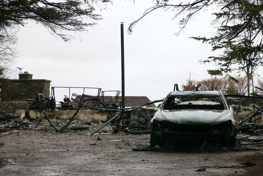 The remains of a home at 200 Portapique Beach Road in Portapique, N.S., on May 7. According to property records, this was one of the properties owned by the gunman and was destroyed during his shooting rampage on April 18 and 19, 2020.