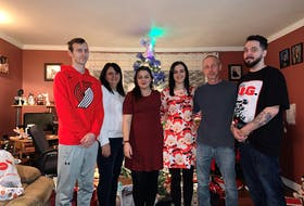 The James family poses for a family photo on Christmas Day in St. Philip's, two days after Chris arrived home from Toronto with a double-lung transplant.  From left are Brandan, mother Kim, Cassie, Candace, father Keith, and Chris.
