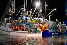 Nova Scotia fishing crews tend to last minute details for the start of the LFA 34 commercial lobster season, Dec. 8. TINA COMEAU PHOTO