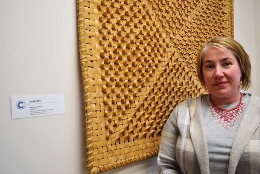 The Cape Breton Centre for Craft and Design in downtown Sydney is looking to diversify its membership with the help of two new hires says executive director Lori Burke, who is standing next to a large piece of traditional Mi'kmaq basketry woven with birch and sweet grass by artist Margaret Johnson. ARDELLE REYNOLDS • SALTWIRE NETWORK