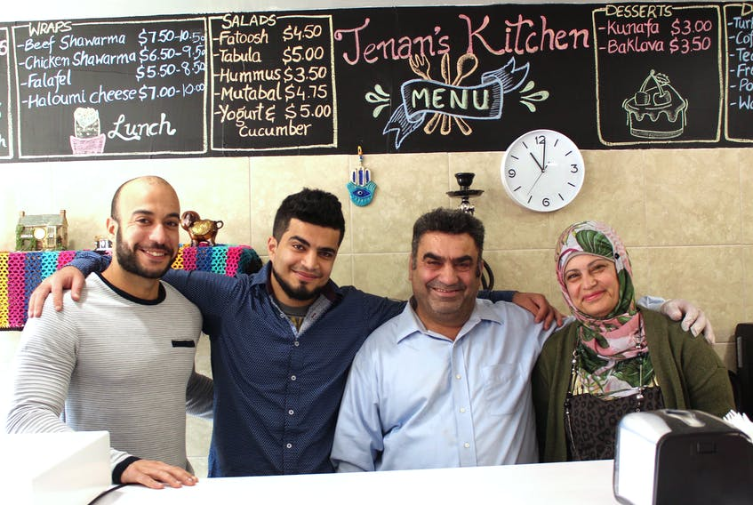 The owners of Jenan's Syrian's Kitchen in downtown Sydney, left to right, Ahmed Barakat and Abdullah Alhsso, along with Abdullah's parents Ahmad Alhsso and Jenan Alahmad. The restaurant offers dishes the family once served at their own large gatherings back in Syria. CAPE BRETON POST