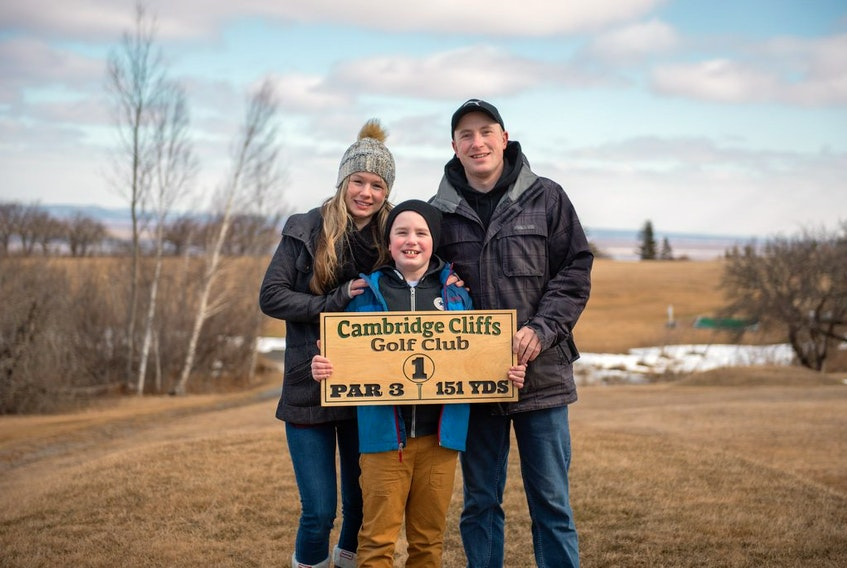 Lucas Wilson and his wife, Tiffany, purchased the former Minas View Golf Links earlier this year, renaming it Cambridge Cliffs Golf Club and undertaking some necessary renovations. It's almost ready to reopen to the public. Pictured with them is their son, Carter.