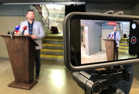 St. John's City Coun. Jamie Korab —council lead on St. John's Sports & Entertainment speaks to  reporters on the main concourse of Mile One Centre Wednesday.  Joe Gibbons/The Telegram