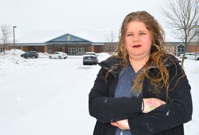 Jennifer Gallant of New Waterford stands out in front of Greenfield Elementary School in River Ryan, upset after she says her seven-year old daughter was recently held down by two boys and choked by another on the school grounds at lunch time. Sharon Montgomery-Dupe/Cape Breton Post