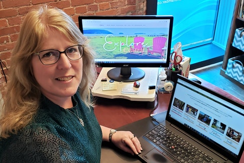 Truro and Colchester Chamber of Commerce executive director Sherry Martell checking out the new Explore Central website.
