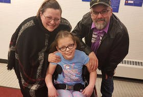 Ten-year-old Claire McDonald poses for a picture with her parents, Jeanine Hannah McDonald and Barry McDonald. — CONTRIBUTED