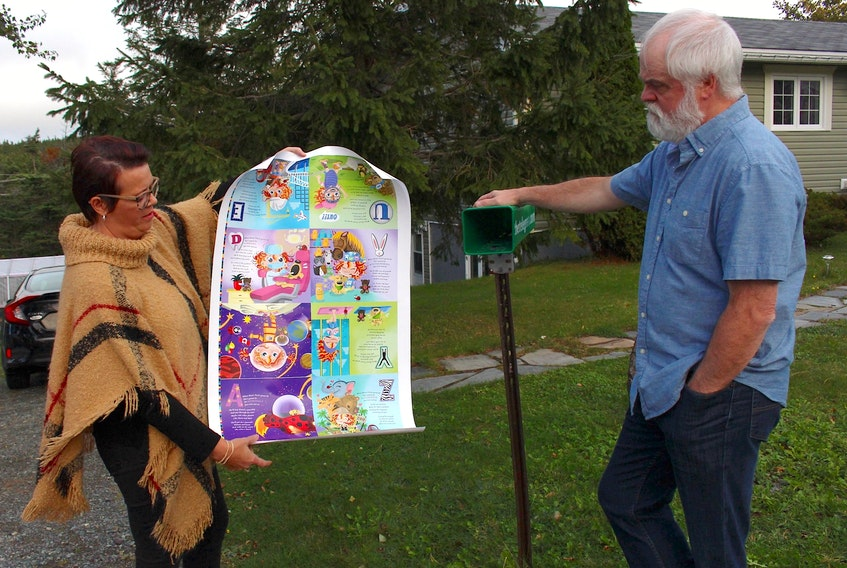 """Author Yvonne Bryant and illustrator Kevin Tobin look over some proofs from the book """"Bizzie Tizzie is Gonna Be Everything from A to Z,"""" which will be released in November. The book is currently being printed and bound. — Andrew Waterman/The Telegram"""