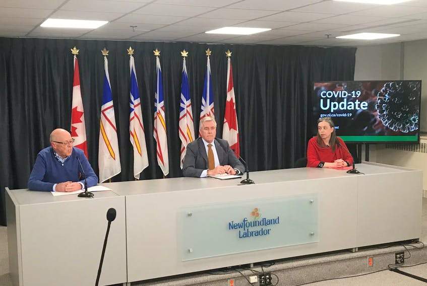 From left, Health Minister John Haggie, Premier Dwight Ball, and Chief Medical Officer Dr. Janice Fitzgerald brief reporters in St. John's Wednesday on the latest COVID-19 developments.