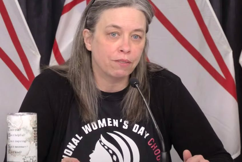 Chief Medical Officer of Health Dr. Janice Fitzgerald wore an International Women's Day sweatshirt for Monday's COVID-19 briefing. (image from YouTube)
