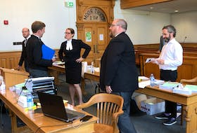 Lawyers on both sides of a constitutional challenge to the Government of Newfoundland and Labrador's COVID-19-related travel ban — Mark Sheppard, Justin Mellor and Don Anthony for the province, John Drover for complainant Kim Taylor, and Rosellen Sullivan for the Canadian Civil Liberties Association — during a break in the hearing in Newfoundland and Labrador Supreme Court Thursday.