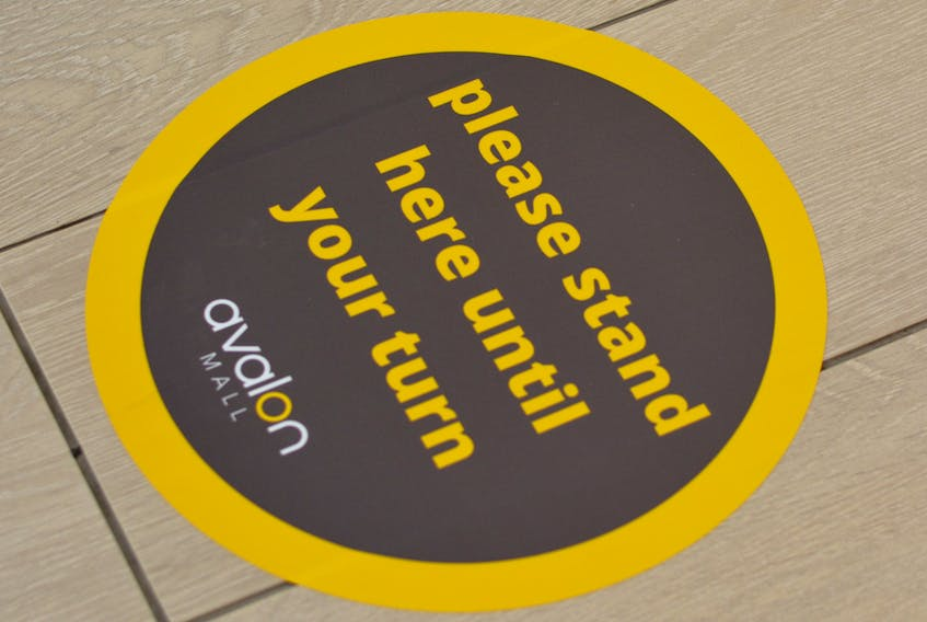 Last year, the Avalon Mall installed signage and floor decals with instructions or warnings to help shoppers.  — Telegram file photo