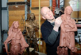 In this file photo Morgan MacDonald works on a clay statue of Demasduit, one of three he sculpted in 2018 as a personal project to help tell and commemorate the history of the Beothuk people. Also shown are sculptures of Shanawdithit (far left) and Nonosabasut (in bronze) in his foundry shop in Logy Bay. Saltwire File Photo