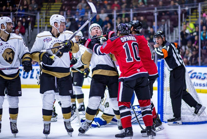 In this Oct. 18, 2019 file photo, Lindsay Sparks (10) of the Brampton Beast gets his stick up on Newfoundland Growlers captain James Melindy in front of the Growlers' net during their game at Mile One Centre in St. John's. The Beast, who were one of the Growlers' most frequent ECHL opponents, and as such could be seen as an arch-rival, are folding operations and will not return to play for the 2021-22 ECHL season. — Newfoundland Growlers photo/Jeff Parsons