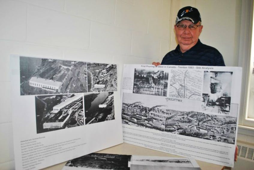 Don Hussher shows displays made by John Ashton with information pertaining to the first pouring of steel in Trenton.