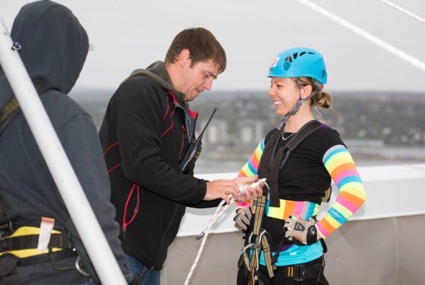 Jillian Sexton, chief operating officer at Hector Building Supplies and co-owner of the Timbermart store in Charlottetown, preparing to rappel in 2014.