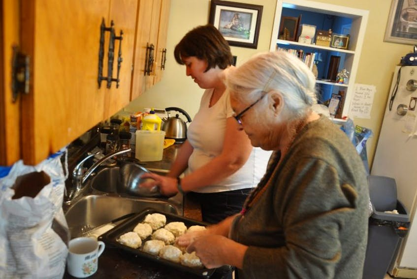 Rosalie Little and VON continuing care assistant Wendy MacCallum prepare supper at Little's residence in Hopewell. Little takes advantage of several services provided by the VON, which allow her to remain living in her own home.