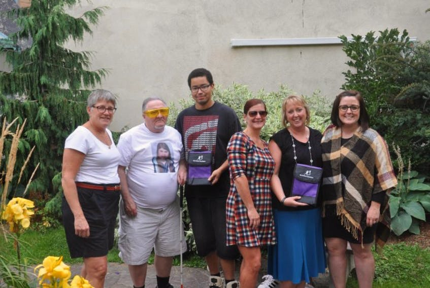 Anne Blandford, left, Calvin Lamb, Jordan Cromwell, Arlene MacDonald, Kerri MacDonald and Nicole LeBlanc were among the many at Murdoch Park for the most recent announcement from Big Brothers Big Sisters of Pictou County.