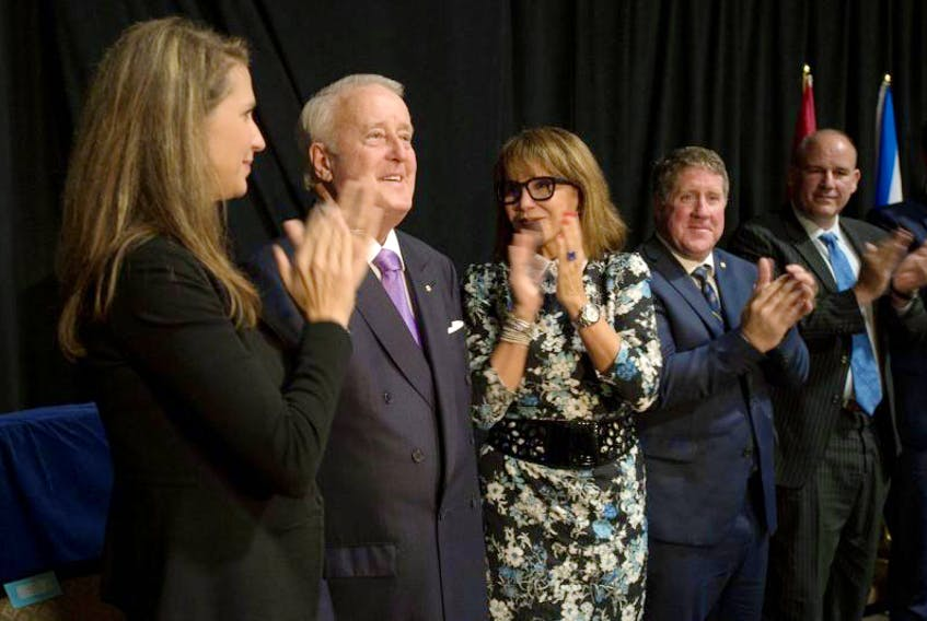 Brian Mulroney is applauded by his daughter Caroline and wife Dr. Mila Mulroney after his speech during sod turning for the Brian Mulroney Institute of Government and Mulroney Hall building at StFX Wednesday.