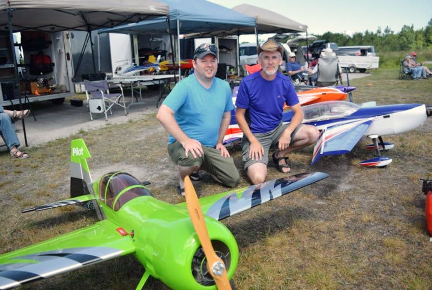 Ben Lann, left, and Paul Sinnis are pictured with their model planes.