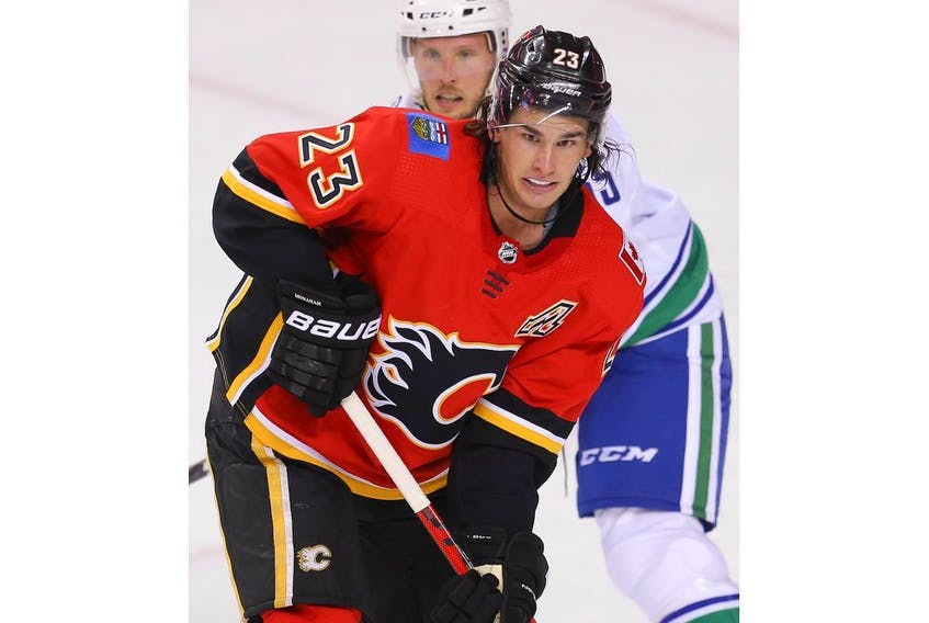 Calgary Flames Jakob Pelletier during warm-up before facing the Vancouver Canucks during pre-season NHL hockey in Calgary on Monday September 16, 2019. Al Charest / Postmedia