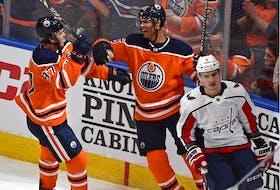Edmonton Oilers' defenceman Darnell Nurse, centre, celebrates his goal against the Washington Capitals with teammate Connor McDavid during NHL regular season action in Edmonton.