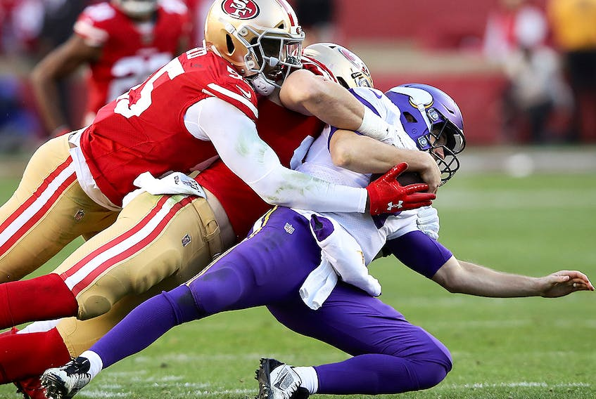 Kirk Cousins of the Minnesota Vikings is sacked by Nick Bosa and Dee Ford of the San Francisco 49ers during the NFC Divisional Round playoff game at Levi's Stadium on January 11, 2020 in Santa Clara, California. (Sean M. Haffey/Getty Images)