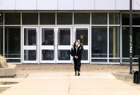 High school students leave their building after schools were closed March 13 due to the COVID-19 pandemic. The Government of Newfoundland and Labrador announced on Thursday that all public and high school exams are cancelled this year.