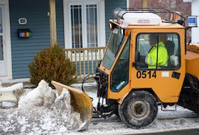 """In this file photo, a City of St. John's snowclearing crew member clears and salts a section of sidewalk on Empire Avenue. On Wednesday, Coun. Ian Froude said while the city's made """"incremental improvements"""" to sidewalk snowclearing over the past three years, his motion for increased spending and more substantial change did not meet the majority of council's approval. -TELEGRAM FILE PHOTO"""