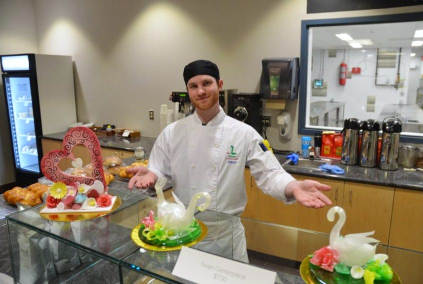 Nova Scotia Community College Kingstec Campus second year Culinary Arts student Mike Foote of Woodville is looking forward to managing one of the food stations at the upcoming 'Nosh' gala. Here, Foote shows off the work of Baking and Pastry program students.