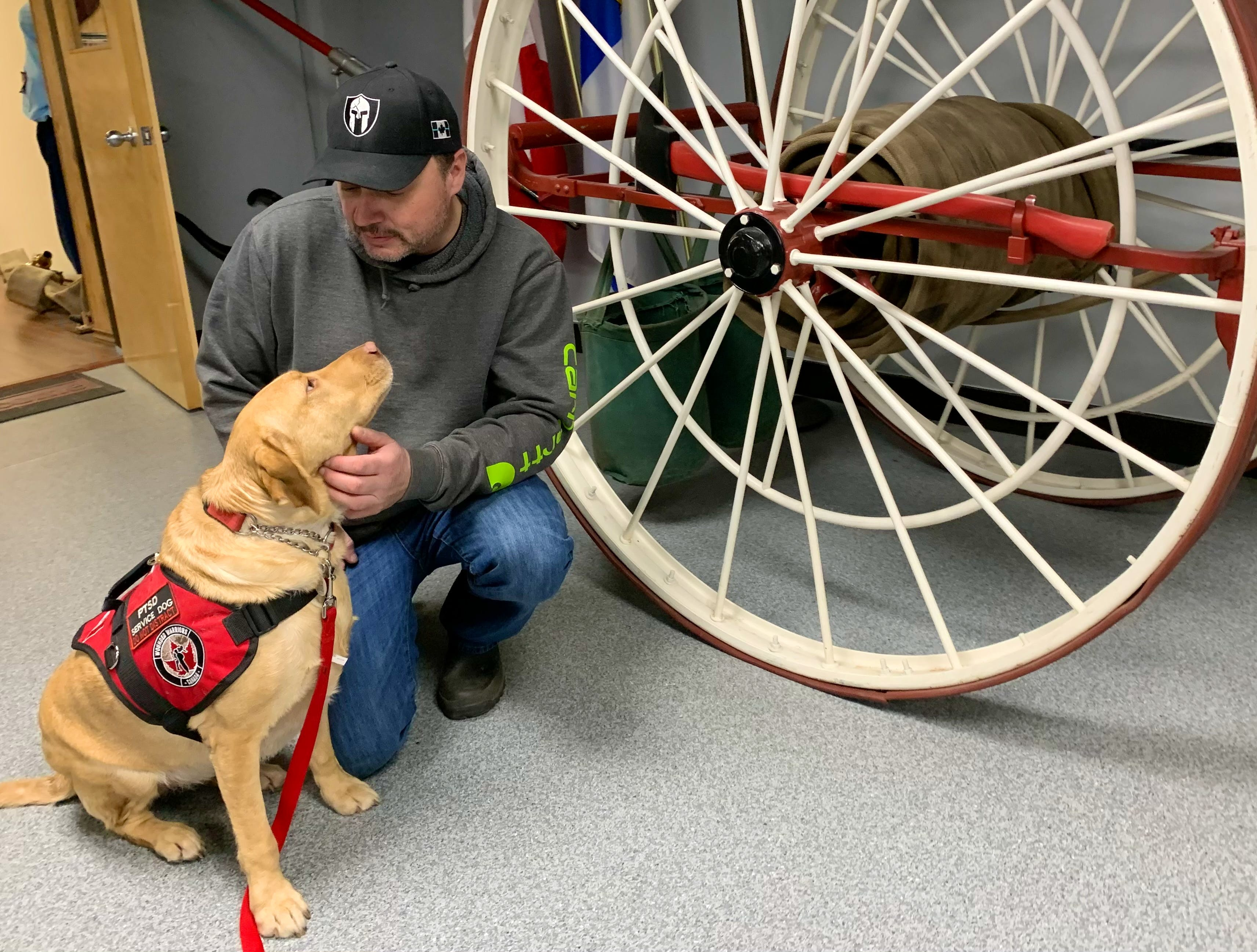 Volunteer firefighter Doug Pynch says Catie, his PTSD service dog, wasn't well-trained when he received her in 2018. He said he knew something wasn't right, but he kept Catie as they tried to help her become a proper service dog.