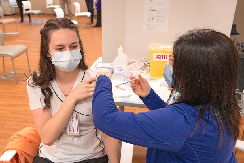 Nurse Zoe Ahern of the Colchester East Hants Health Centre in Truro is the first Northern Zone health-care worker to receive a dose of COVID vaccine.