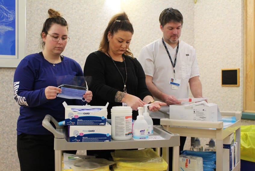 Nova Scotia Health Authority staff preparing supplies at the COVID-19 assessment centre at the Cape Breton Regional Hospital including Savanna Power, left, admitting clerk, Melissa Kuba, ward clerk and Trevor MacKinnon, RN. On Tuesday Nova Scotia's chief medical officer Dr. Robert Strang confirmed two new cases of the coronavirus, bringing the total to seven, one which has come back confirmed from the National Microbiology Lab in Winnipeg. CONTRIBUTED