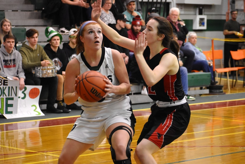 Avery McKinnon of the Breton Education Centre Bears, left, looks to shoot as she's watched by Maddie Long of the Northumberland Nighthawks during New Waterford Coal Bowl Classic action at the BEC gym last February. - Jeremy Fraser