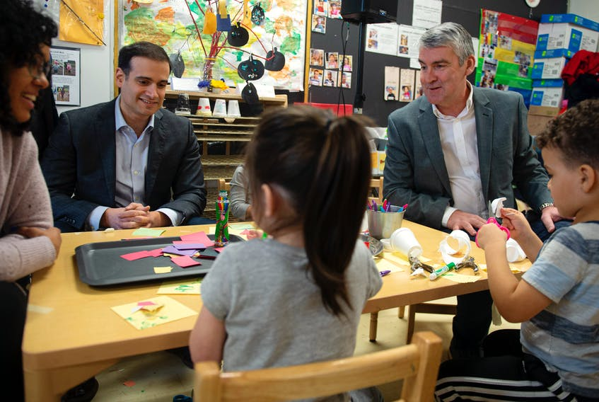 Education Minister Zach Churchill and Premier Stephen McNeil talk with students and staff prior to a pre-primary nnouncement at Chebucto Heights Elementary earlier this month. An expert in work sociology says these kinds of programs can help boost family incomes. - File
