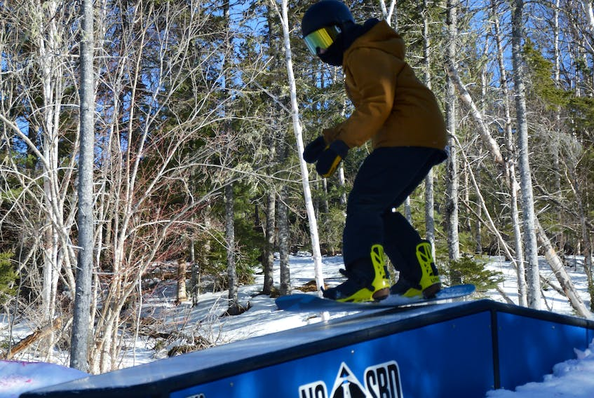 Maddux Marsh of North Sydney hits one of the snowboard boxes during training at Ski Ben Eoin on Wednesday. The 13-year-old will be participating in his first-ever Nova Scotia Snowboard provincial event this weekend at the Ben Eoin venue. JEREMY FRASER • CAPE BRETON POST