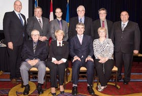 <p>Members of the Nova Scotia Trunked Mobile Radio 2 (TMR2) project were congratulated June 7 on receiving the Premier's Award of Excellence. Pictured here are, from left, back row: Public Service Commission Minister Labi Kousoulis, Scott Hawkes, Matthew Boyle, Todd Brown, Deputy Minister Jeffrey Conrad, and Paul Maynard; front row: Tom Conrad, Suzan MacLean, Premier Stephen McNeil, and Marion Pye.</p>